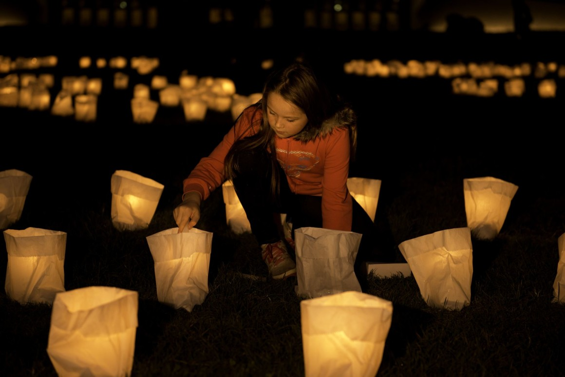 Earth Hour Night 2014: Young girl lighting a candle, Canberra, A